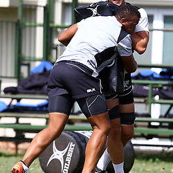 DURBAN, SOUTH AFRICA, 25 January 2016 - Ruan Botha tackling Ruan Botha during The Cell C Sharks Pre Season training for the 2016 Super Rugby Season at Growthpoint Kings Park in Durban, South Africa. (Photo by Steve Haag)<br /> images for social media must have consent from Steve Haag