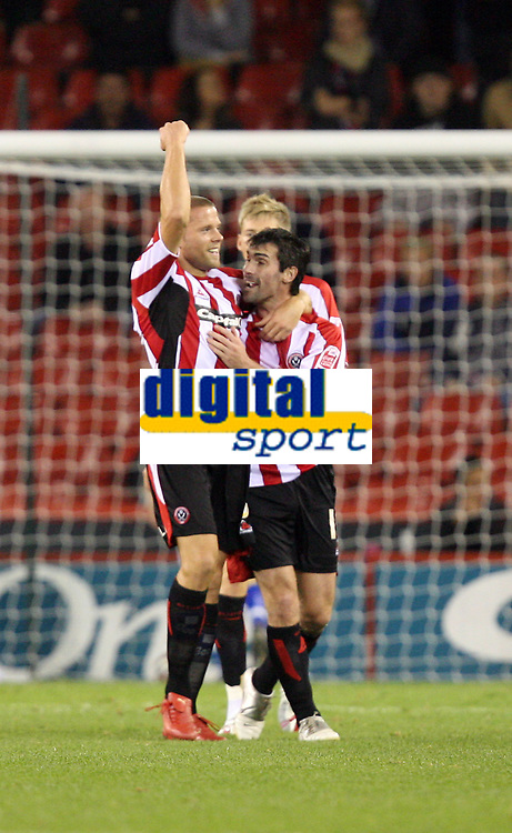 Photo: Paul Greenwood.<br />Sheffield United v Cardiff City. Coca Cola Championship. 02/10/2007.<br />Sheffield Utd's James Beattie (L) celebrates his goal with Keith Gillespie