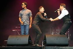 © Licensed to London News Pictures. 16/07/2015<br /> Rochester Castle Concerts,Rochester,Kent<br /> blue singing.<br /> Antony Costa and Duncan James dancing with left  Simon Webbe<br /> (Byline:Grant Falvey/LNP)