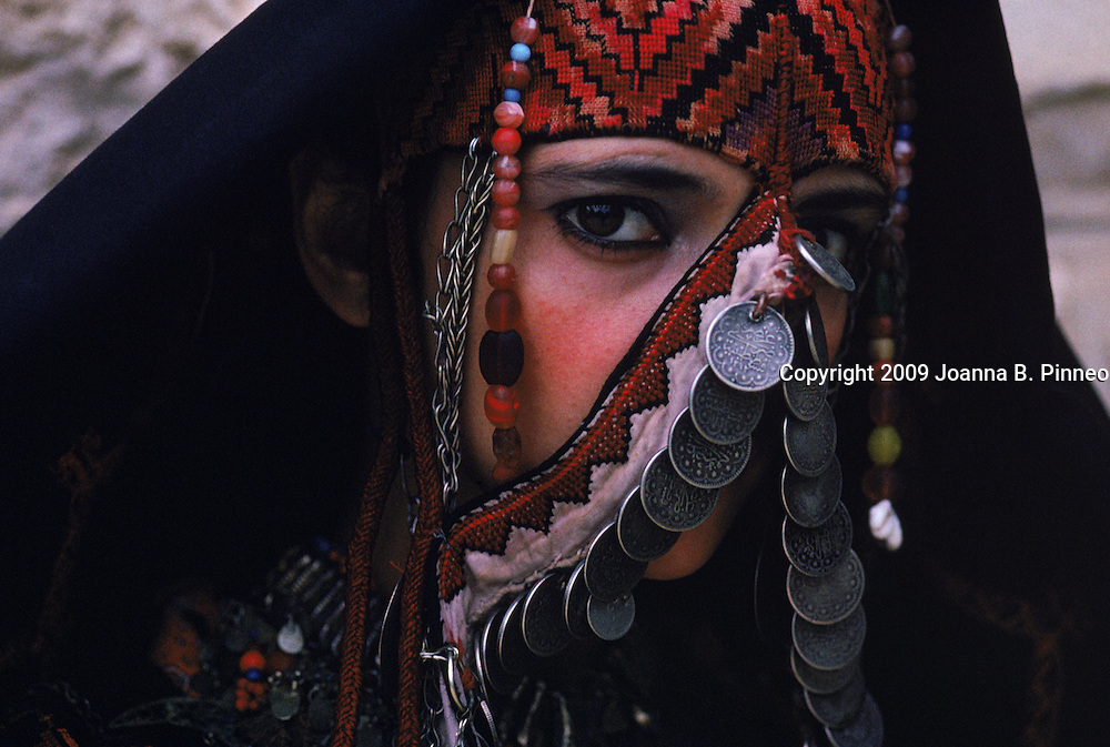 Palestinian woman models a traditional costume.