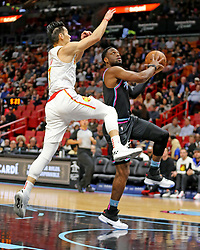 November 27, 2018 - Miami, FL, USA - Miami Heat's Dwyane Wade makes a basket in the first quarter as Atlanta Hawks' Jeremy Lin fails to defend on Tuesday, Nov. 27, 2018 at the AmericanAirlines Arena in Miami, Fla. (Credit Image: © Charles Trainor Jr/Miami Herald/TNS via ZUMA Wire)