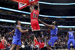 November 12, 2018 - Chicago, IL, USA - Chicago Bulls forward Wendell Carter Jr. (34) dunks the ball during the first half against the Dallas Mavericks at the United Center Monday, Nov. 12, 2018 in Chicago. (Credit Image: © Armando L. Sanchez/Chicago Tribune/TNS via ZUMA Wire)