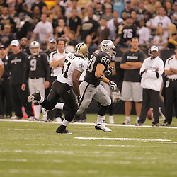 2008 October, 12: Oakland Raiders tight end Zach Miller (80) runs away from New Orleans Saints linebacker Jonathan Vilma (51) during a week six regular season game between the Oakland Raiders and the New Orleans Saints at the Louisiana Superdome in New Orleans, LA.