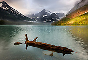 Stormlight and mist add drama to this study of Lake Josephine and Mount Gould,  in the Many Glacier region of Glacier National Park, Montana, USA