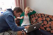 Trainer Niels bekijkt de SRM-data met Christien Veelenturf van haar trainingsronde. Het Human Power Team Delft en Amsterdam (HPT), dat bestaat uit studenten van de TU Delft en de VU Amsterdam, is in Senftenberg voor een poging het uurrecord te verbreken op de Dekrabaan met de VeloX4. In september wil het HPT daarna een poging doen het wereldrecord snelfietsen te verbreken, dat nu op 133 km/h staat tijdens de World Human Powered Speed Challenge.<br /> <br /> The Human Power Team Delft and Amsterdam, consisting of students of the TU Delft and the VU Amsterdam, is in Senftenberg (Germany) for the attempt to set a new hour record on a bicycle with the special recumbent bike VeloX4. They also wants to set a new world record cycling in September at the World Human Powered Speed Challenge. The current speed record is 133 km/h.