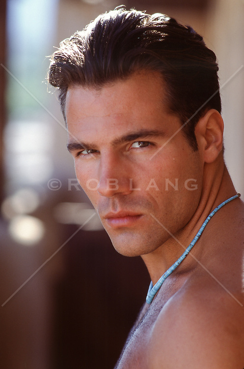 portrait of a sexy man with full lips outdoors