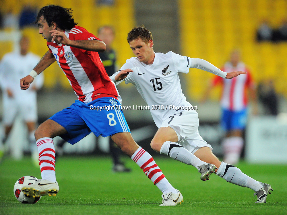 Michael McGlinchey (right) pressures Paraguay's Osmar Molinas. International football friendly - New Zealand All Whites v Paraguay at Westpac Stadium, Wellington on Tuesday, 12 October 2010. Photo: Dave Lintott / photosport.co.nz