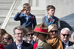 © Licensed to London News Pictures. 25/04/2017. London, UK. A young boy salutes as the ANZAC ceremony takes place at the Cenotaph in Whitehall. A dawn ceremony and service was held at The Australian War Memorial and The New Zealand War Memorial at Hyde Park Corner.  April 25th is the day that Australia and New Zealand remember the dead of all wars. Photo credit: Peter Macdiarmid/LNP