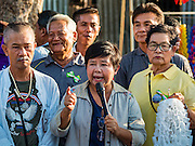 10 SEPTEMBER 2016 - BANGKOK, THAILAND: Community leaders speak to the crowd at a party in Pom Mahakan. Forty-four families still live in the Pom Mahakan Fort community. The city of Bangkok has given them provisional permission to stay, but city officials say the permission could be rescinded and the city go ahead with the evictions. The residents of the historic fort have barricaded most of the gates into the fort and are joined every day by community activists from around Bangkok who support their efforts to stay.                PHOTO BY JACK KURTZ