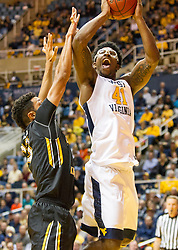 Nov 13, 2015; Morgantown, WV, USA; West Virginia Mountaineers forward Devin Williams shoots under the basket during the first half against the Northern Kentucky Norse at WVU Coliseum. Mandatory Credit: Ben Queen-USA TODAY Sports