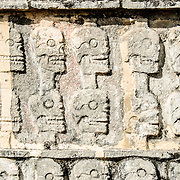 Depiction of skulls carved in stone at Chichen Itza, Mexico.