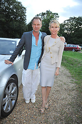STING and TRUDIE STYLER at a Summer party hosted by Lady Annabel Goldsmith at her home Ormeley Lodge, Ham, Surrey on 14th July 2009.