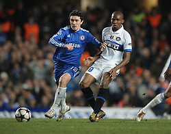 Samuel Eto'o of Inter Milan and Yuri Shirkov of Chelsea in action during the second leg of the round of 16 UEFA Champions League match at home to Chelsea at Stamford Bridge football stadium, London on March 16, 2010.