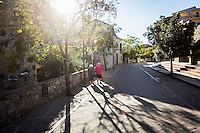 ACCIAROLI (POLLICA), ITALY - 5 OCTOBER 2016: An elderly couple walks in the historical center of Acciaroli, a hamlet in the municipality of Pollica, Italy, on October 5th 2016.<br /> <br /> To understand how people can live longer throughout the world, researchers at University of California, San Diego School of Medicine have teamed up with colleagues at University of Rome La Sapienza to study a group of 300 citizens, all over 100 years old, living in Acciaroli (Pollica), a remote Italian village nestled between the ocean and mountains in Cilento, southern Italy.<br /> <br /> About 1-in-60 of the area's inhabitants are older than 90, according to the researchers. Such a concentration rivals that of other so-called blue zones, like Sardinia and Okinawa, which have unusually large percentages of very old people. In the 2010 census, about 1-in-163 Americans were 90 or older.