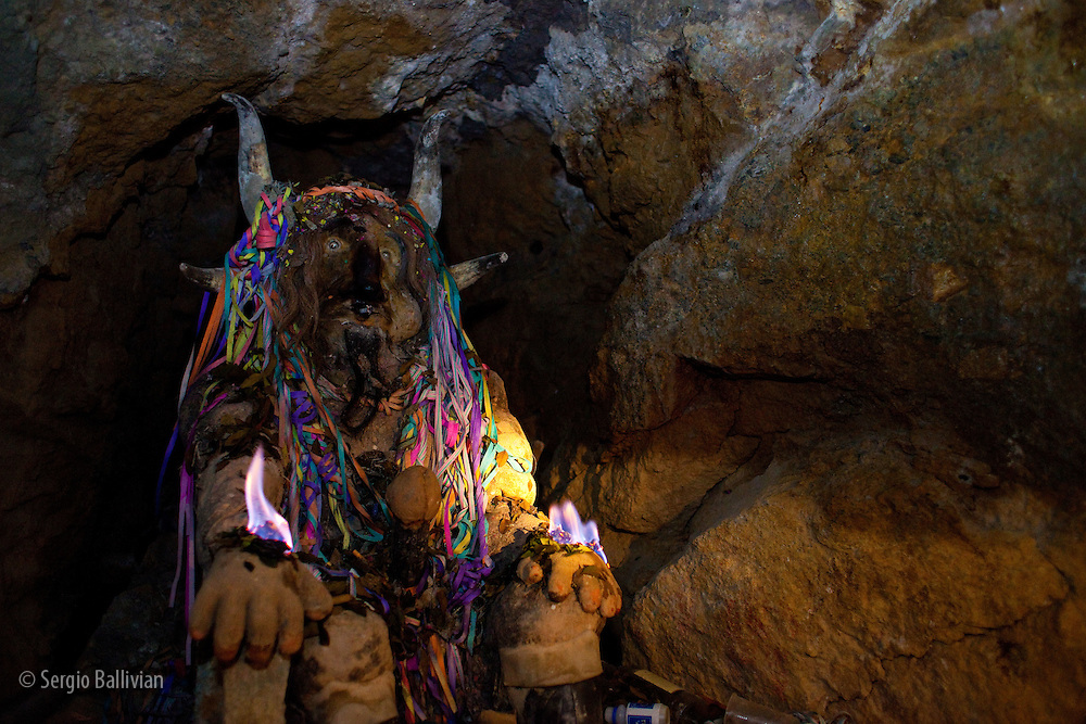 "A statue of El ""Tio"" (the Devil) as seen inside a mine shaft in the Cerro Rico in Potosi, Bolivia.  Miners pay homage and ask permission to extract the minerals every time they go inside the mine, where women are not allowed to enter.  They offer coca leaves, alcohol, tobacco and fire as part of a ceremony called ""pijchar""."