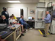 Adjunct Lecturer Ed Fess, Research and Development Manager at OptiPro, teaches an optics class at MCC on January 22, 2014.