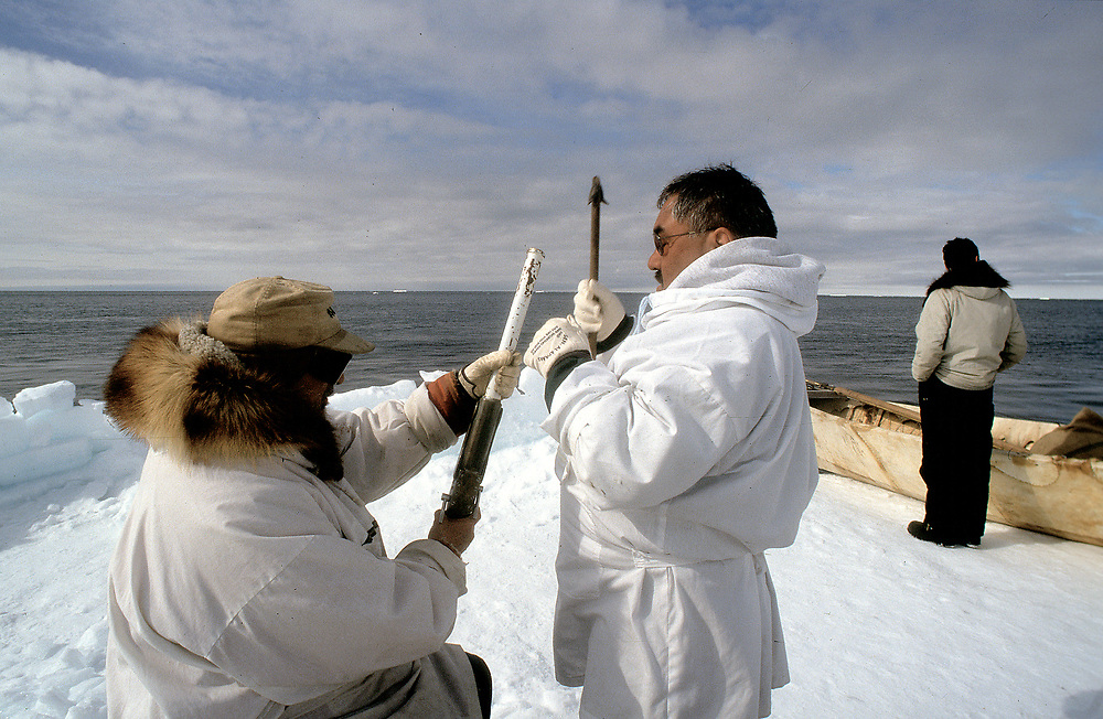 Captain of a native whaling team preparing harpoons to hunt for bowhead whales, Barrow, Alaska