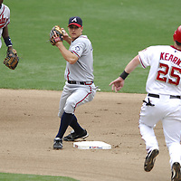 17 May 2006:   Atlanta Braves second baseman Kelly Johnson (L) completes a double play to end the 7th inning on a ball hit by Washington Nationals first baseman Tony Batista as right fielder Austin Kearns (25) slides into second base. The Nationals defeated the Braves 4-3 at RFK Stadium in Washington, D.C.