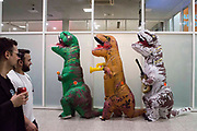 UNITED KINGDOM, London: 26 May 2019 <br /> Cosplayers dressed as inflatable T-Rex's make their way through London ExCeL during the final day of the MCM London Comic Con. The three day comic convention is being held at London ExCeL from Fri 24th - Sun 26th of May.