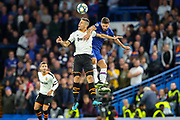 Chelsea forward Olivier Giroud (18) and Valencia CF defender Gabriel (5) clash in the air during the Champions League match between Chelsea and Valencia CF at Stamford Bridge, London, England on 17 September 2019.
