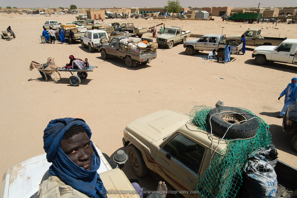 Pick-ups used to transport goods and people are seen in the main square of Fassala, Mauritania on a market day on 4 March 2013.