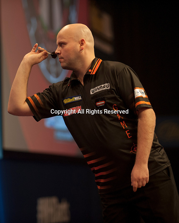 18.12.2014.  London, England.  William Hill PDC World Darts Championship.  Christian Kist [NED] in action during his game with Jelle Klaasen (29) [NED]