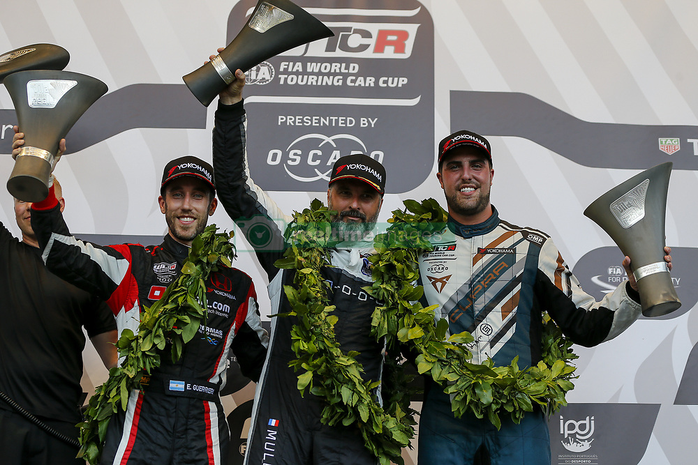 June 23, 2018 - Vila Real, Vila Real, Portugal - Yvan Muller (C) first place, Esteban Guerrieri (L) second place and Pepe Oriola (R) third place in the podium ceremony of the Race 1 during the FIA WTCR 2018 World Touring Car Cup Race of Portugal, Vila Real, June 23, 2018. (Credit Image: © Dpi/NurPhoto via ZUMA Press)
