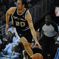 Jan 18, 2010; New Orleans, LA, USA; San Antonio Spurs guard Manu Ginobili (20) drives down court against the New Orleans Hornets during the first half at the New Orleans Arena. Mandatory Credit: Derick E. Hingle-US PRESSWIRE