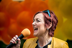 Cabinet Secretary Angela Constance MSP speaks to the crowd before the annual Pride Edinburgh march took place from outside the Scottish Parliament.<br /> <br /> © Dave Johnston/ EEm