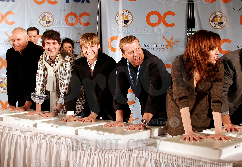 Oct 28, 2004; Newport Beach, CA, USA; Cast & Producers of the FOX hit TV show 'The OC' visited the Balboa Penninsula in Newport Beach to get a Key to the City and be immortalized in cement with thier hand prints to be placed at the enterance to the Historic Balboa Pavillion. (L-R) ALAN DALE, MELINDA CLARKE, JOSH SCHWARTZ, MCG, BENJAMIN MCKENZIE. Mandatory Credit: Photo by Shelly Castellano/ZUMA Press.