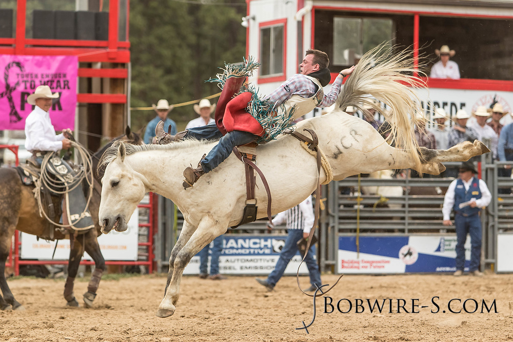 Bareback rider Tim O'Connell rides Summit Pro Rodeo's 949 during the third performance of the Elizabeth Stampede on Sunday, June 3, 2018.