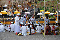 A group of worshippers in an Agong temple ceremony in Bali, Indonesia.