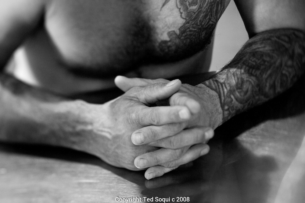 Inmate with tattoos inside the reception housing unit..California State Prison, Los Angeles County.