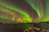 The Northern Lights exhibiting the classic red colour in the upper curtains in addition from the main green lower curtains, with both colours from oxygen. The Pleaides and Hyades are rising at right of centre. <br /> <br /> Taken from the Hurigruten ship the m/s Nordlys north of Troms&oslash; on October 24, 2017. <br /> <br /> This is a single 2-second exposure with the Sigma 14mm Art lens at f/1.8 and Nikon D750 at ISO 6400. Taken as part of a time-lapse sequence.