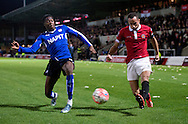 Jerome Wright of FC United of Manchester (right) crosses as Gboly Ariyibi of Chesterfield (left) closes down during the FA Cup match at Broadhurst Park, Moston<br /> Picture by Russell Hart/Focus Images Ltd 07791 688 420<br /> 09/11/2015
