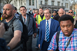 © Licensed to London News Pictures. 29/03/2019. London, UK. Nigel Farage is escorted away by his security after speaking at a Leave Means Leave rally in Parliament Square. MPs have voted to reject Prime Minister Theresa May's withdrawal agreement for a third time today. Photo credit: Rob Pinney/LNP