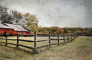 The fence and barns framing a pasture add to an autumn scene in a rural southern Jersey town.