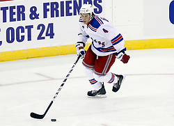 Oct 5, 2009; Newark, NJ, USA; New York Rangers defenseman Michael Del Zotto (4) skates with the puck during the second period at the Prudential Center.