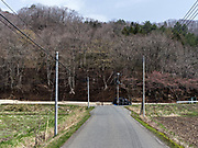 Black sacks containing radiation-contaminated soil sit at the side of the road near Litate village, Japan.
