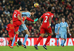 Dejan Lovren of Liverpool challenges Peter Crouch of Stoke City  - Mandatory by-line: Matt McNulty/JMP - 27/12/2016 - FOOTBALL - Anfield - Liverpool, England - Liverpool v Stoke City - Premier League