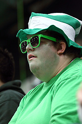 21 February 2015:  Titan fan with a green striped Dr. Suess hat, green beard stubble and green tee during an NCAA women's division 3 CCIW basketball game between the Elmhurst Bluejays and the Illinois Wesleyan Titans in Shirk Center, Bloomington IL