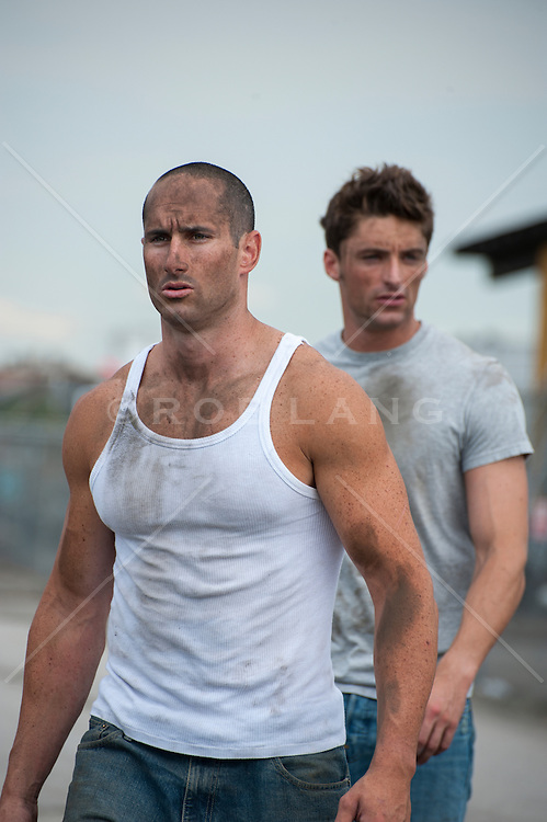 two rugged good looking men with dirt on their clothes and face outdoors