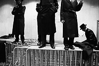 """Borough Park, Brooklyn, New York. Jewish orthodox men standing on barriers viewing the bride and groom dancing in the center of the Synaogogue of the Congregation Shaarei Zion of Bobov. The groom is Zvi Tauber, nephew of Gran Rabbi Ben Zion Halberstam, referred as """"Bobov 48"""", of the Congregation Shaarei Zion of Bobov. Thousands of people, part of this community, were invited to celebrate the public wedding. Gianni Cipriano, cell +1 646 465 2168 (USA), +39 328 567 7923 (Italy), gianni@giannicipriano.com , www.giannicipriano.com"""
