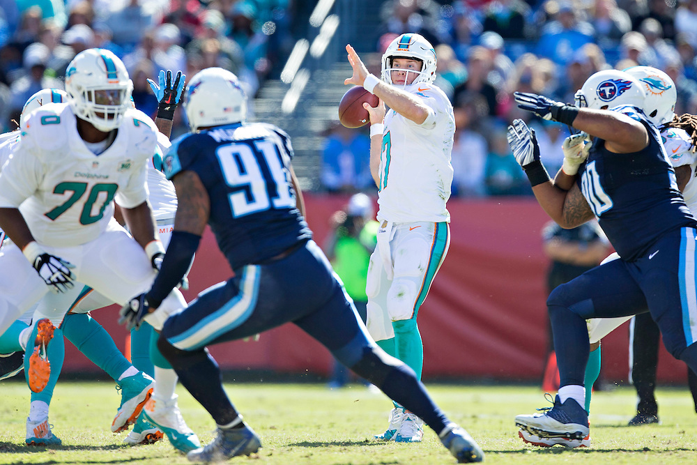 NASHVILLE, TN - OCTOBER 18:  Ryan Tannehill #17 of the Miami Dolphins throws a pass against the Tennessee Titans at LP Field on October 18, 2015 in Nashville, Tennessee.  The Dolphins defeated the Titans 38-10.  (Photo by Wesley Hitt/Getty Images) *** Local Caption *** Ryan Tannehill