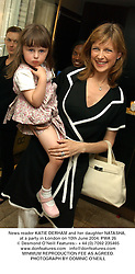 News reader KATIE DERHAM and her daughter NATASHA, at a party in London on 10th June 2004.PWA 26