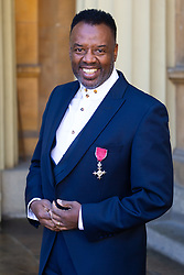 Musician David Grant proudly displays his OBE for services to music following an investiture ceremony at Buckingham Palace in London. London, March 14 2019.