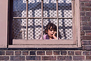 Bored Girl in Window, New York City, New York, USA, September 1982