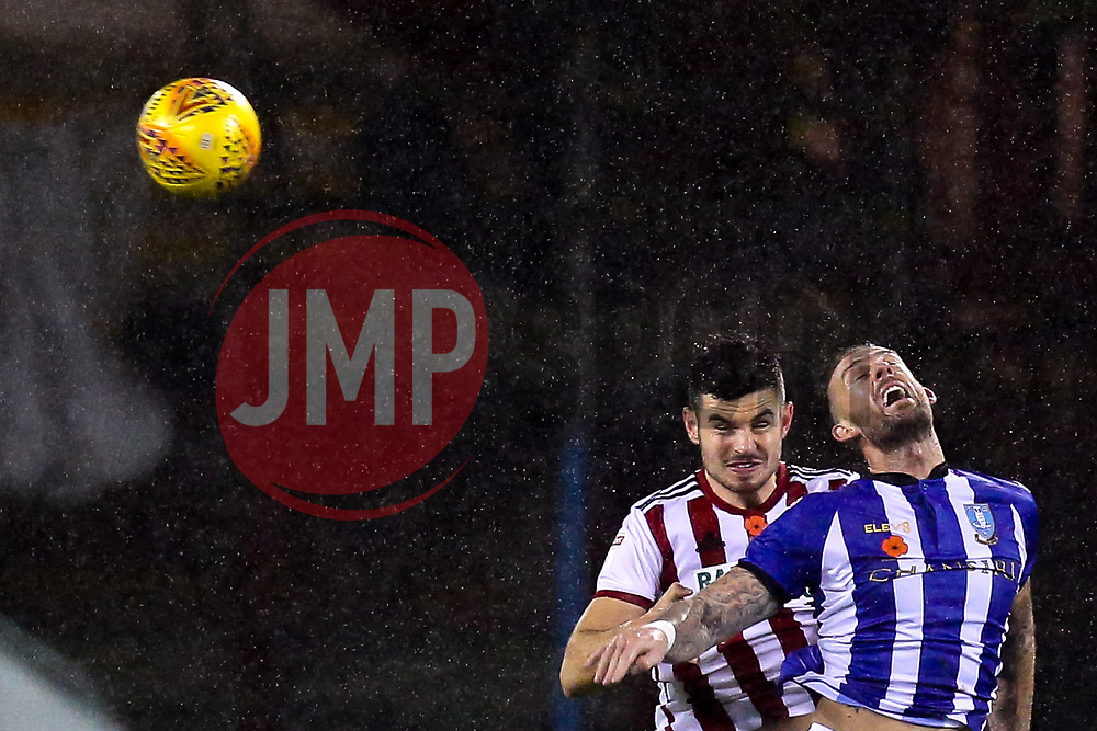 John Egan of Sheffield United challenges Steven Fletcher of Sheffield Wednesday - Mandatory by-line: Robbie Stephenson/JMP - 09/11/2018 - FOOTBALL - Bramall Lane - Sheffield, England - Sheffield United v Sheffield Wednesday - Sky Bet Championship