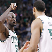 14 May 2012: Boston Celtics power forward Kevin Garnett (5) congratulates Boston Celtics center Ryan Hollins (50) during the Philadelphia Sixers 82-81 victory over the Boston Celtics, in Game 2 of the Eastern Conference semifinals playoff series, at the TD Banknorth Garden, Boston, Massachusetts, USA.