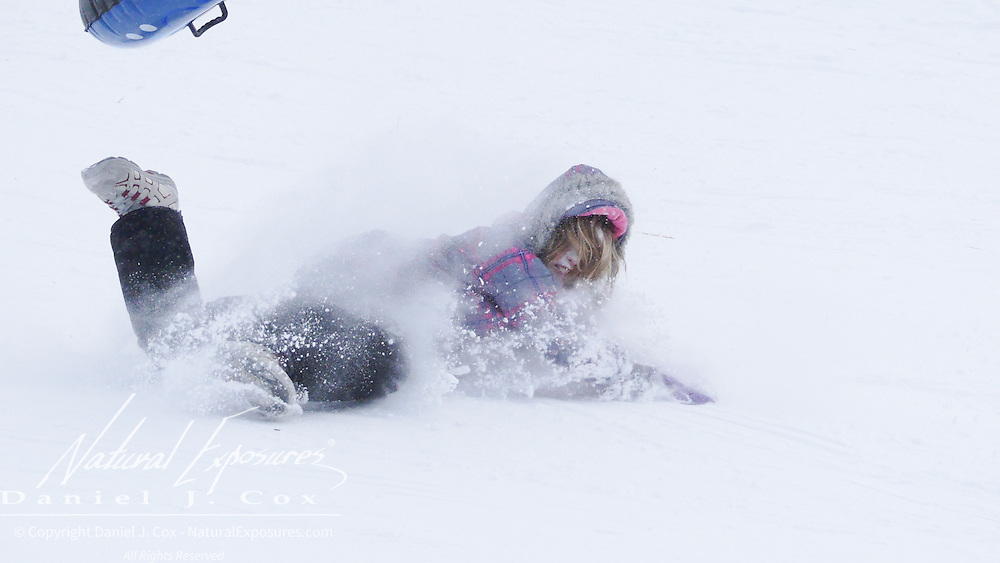 An unidentified young girl sledding on Pete's Hill. Bozeman, Montana